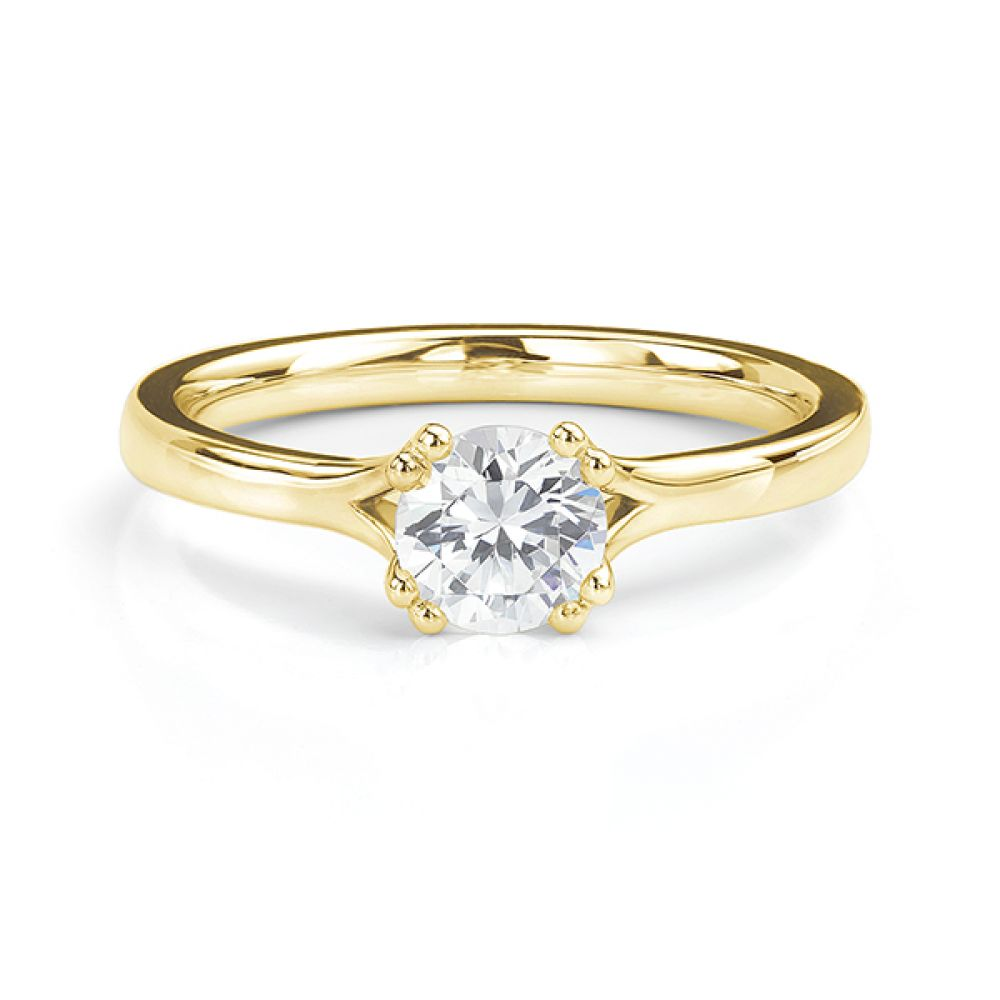 Yellow gold double claw engagement ring front view