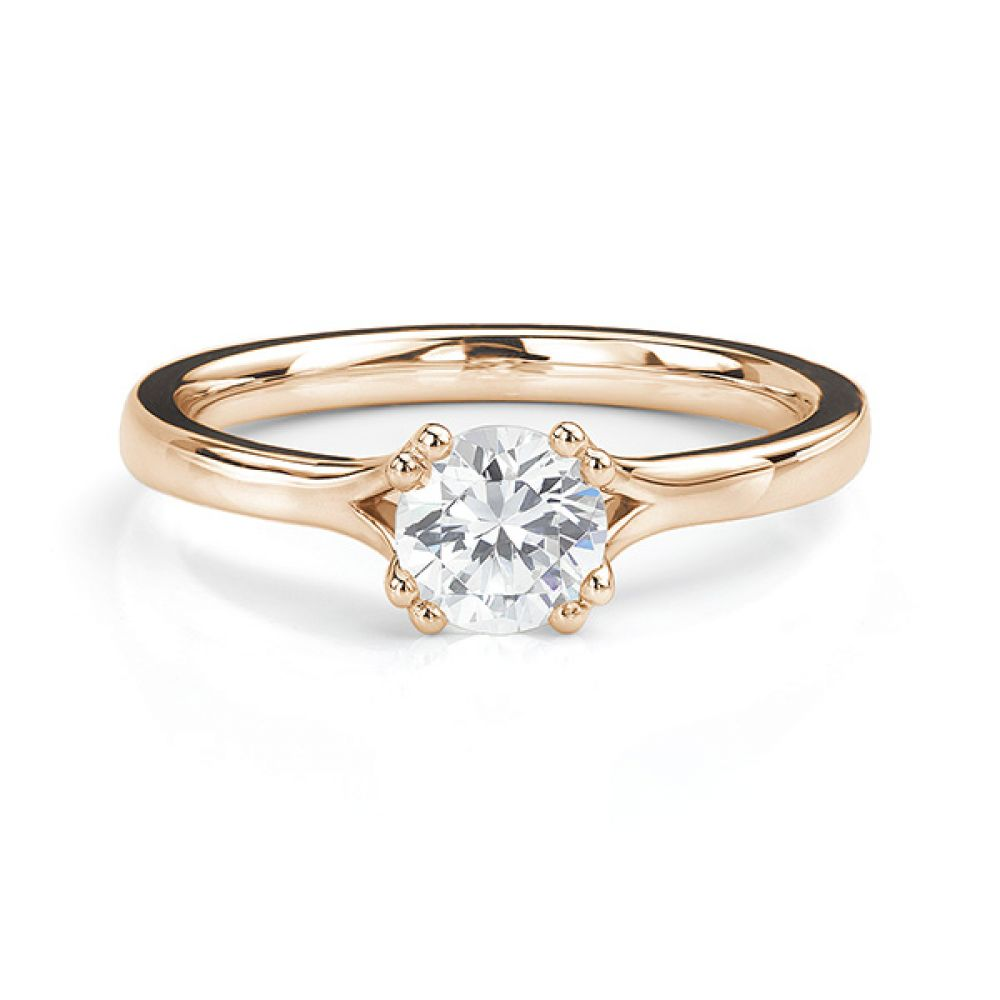 Rose gold double claw engagement ring front view