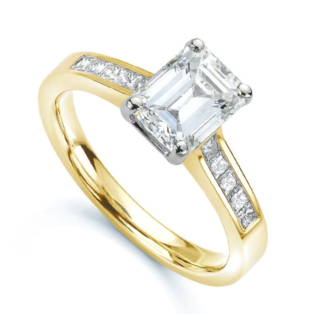 Emerald cut diamond engagement ring with Princess cut diamond shoulders yellow gold