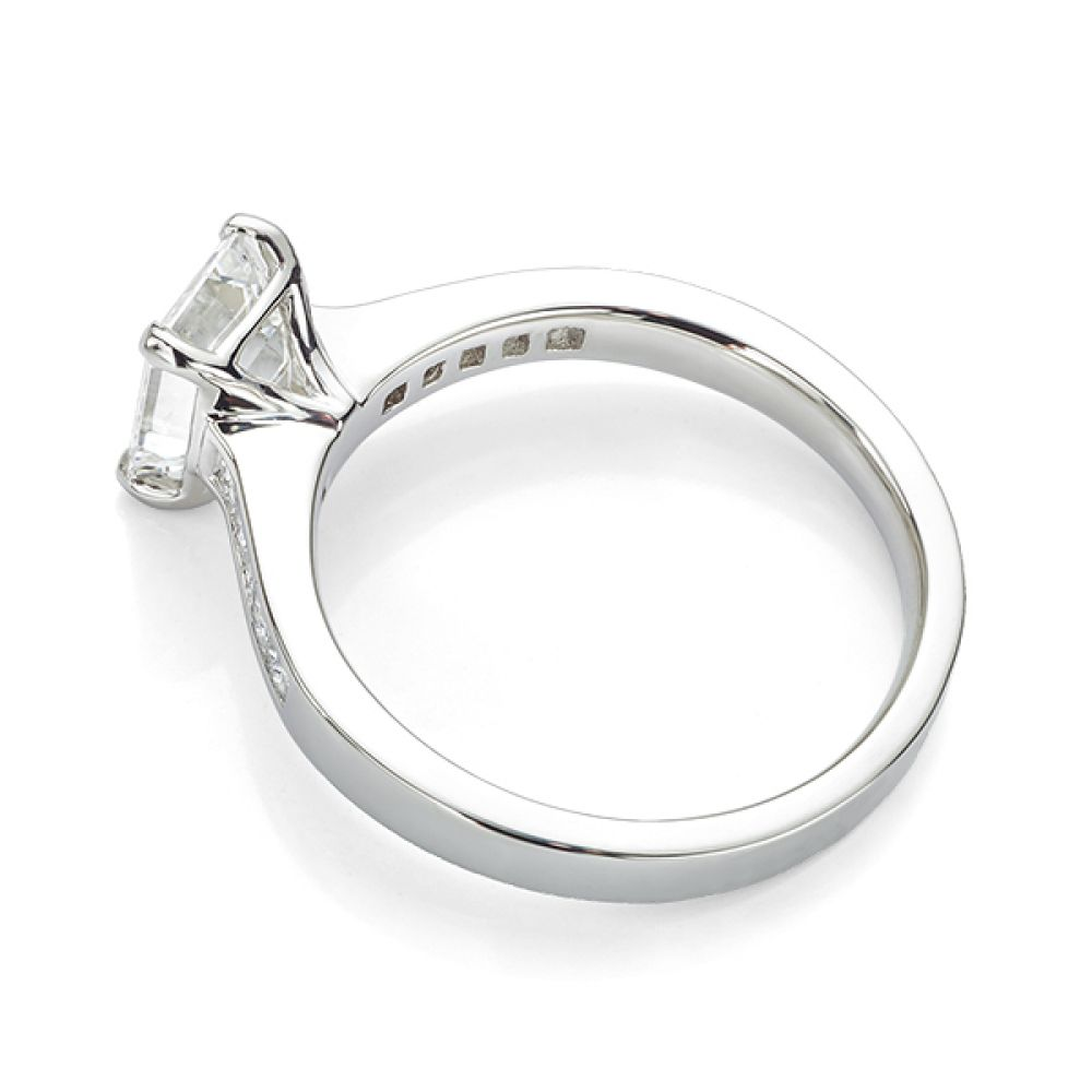 Emerald cut diamond engagement ring with Princess cut diamond shoulders white gold side view