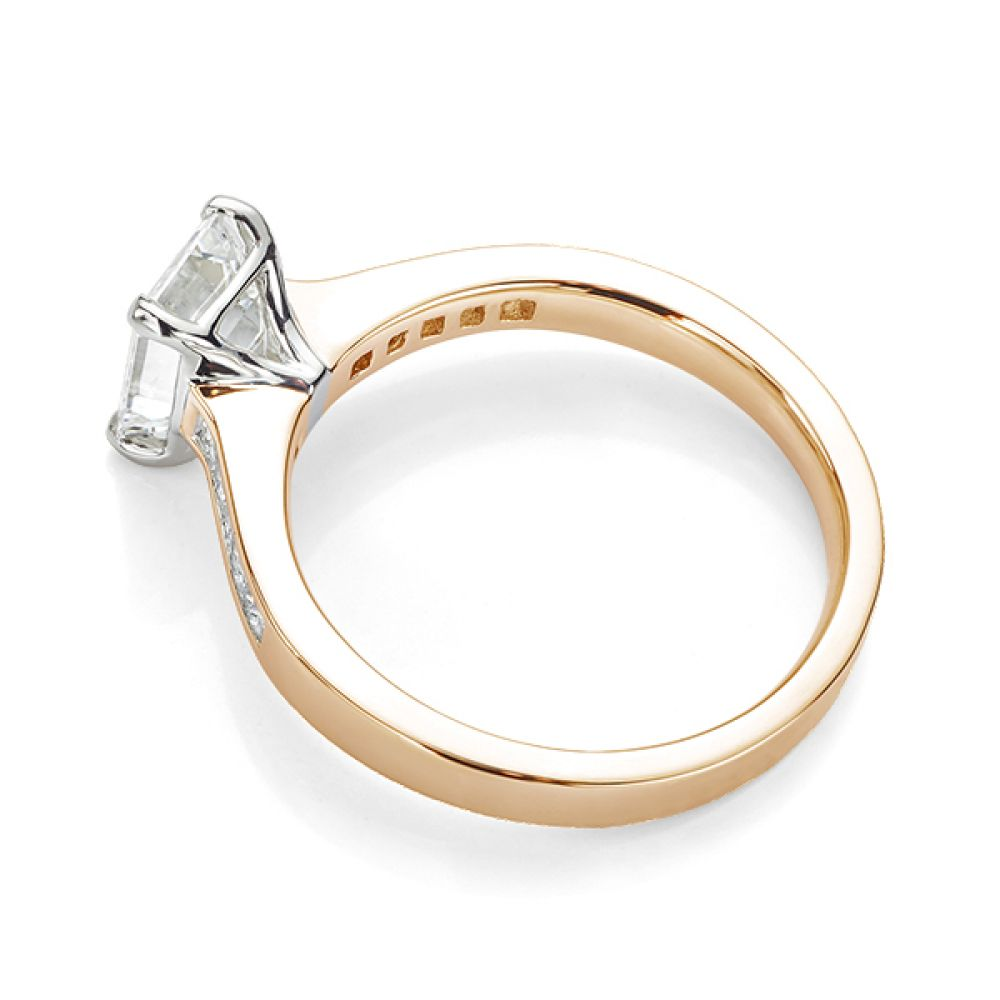 Emerald cut diamond engagement ring with Princess cut diamond shoulders rose gold side view