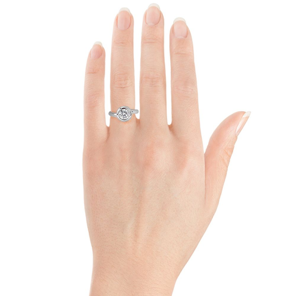 Domed solitaire diamond ring on the hand
