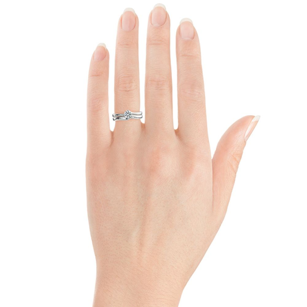Twist engagement ring shown with shaped wedding ring for twist design