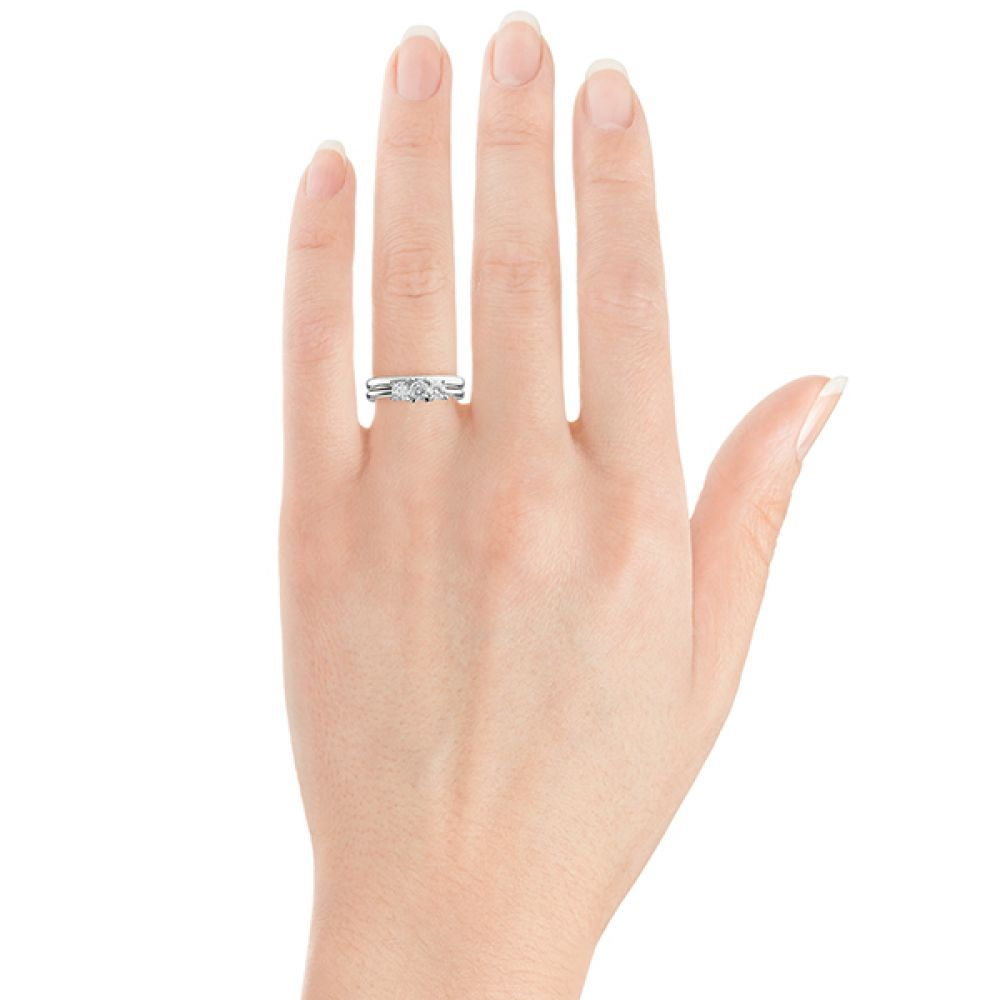 Ciel three stone engagement ring on hand