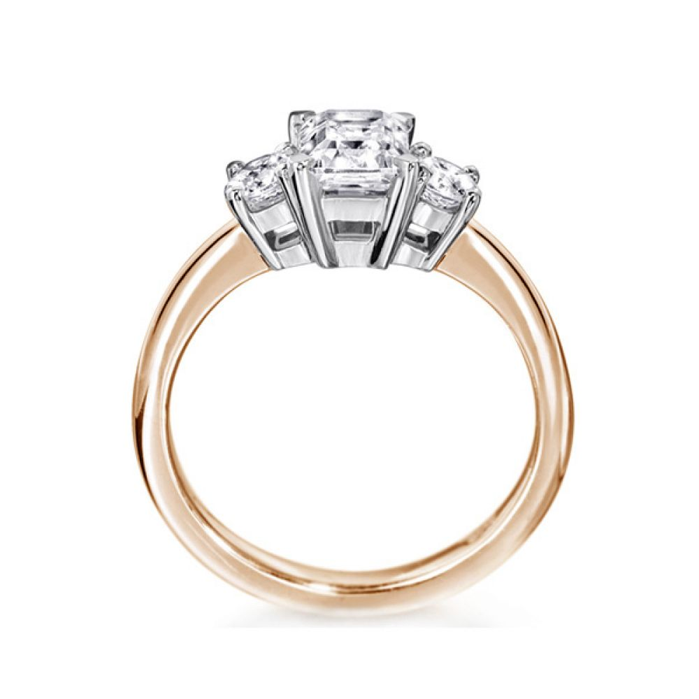 3 Stone Emerald Cut & Round Diamond Engagement Ring Side View In Rose Gold
