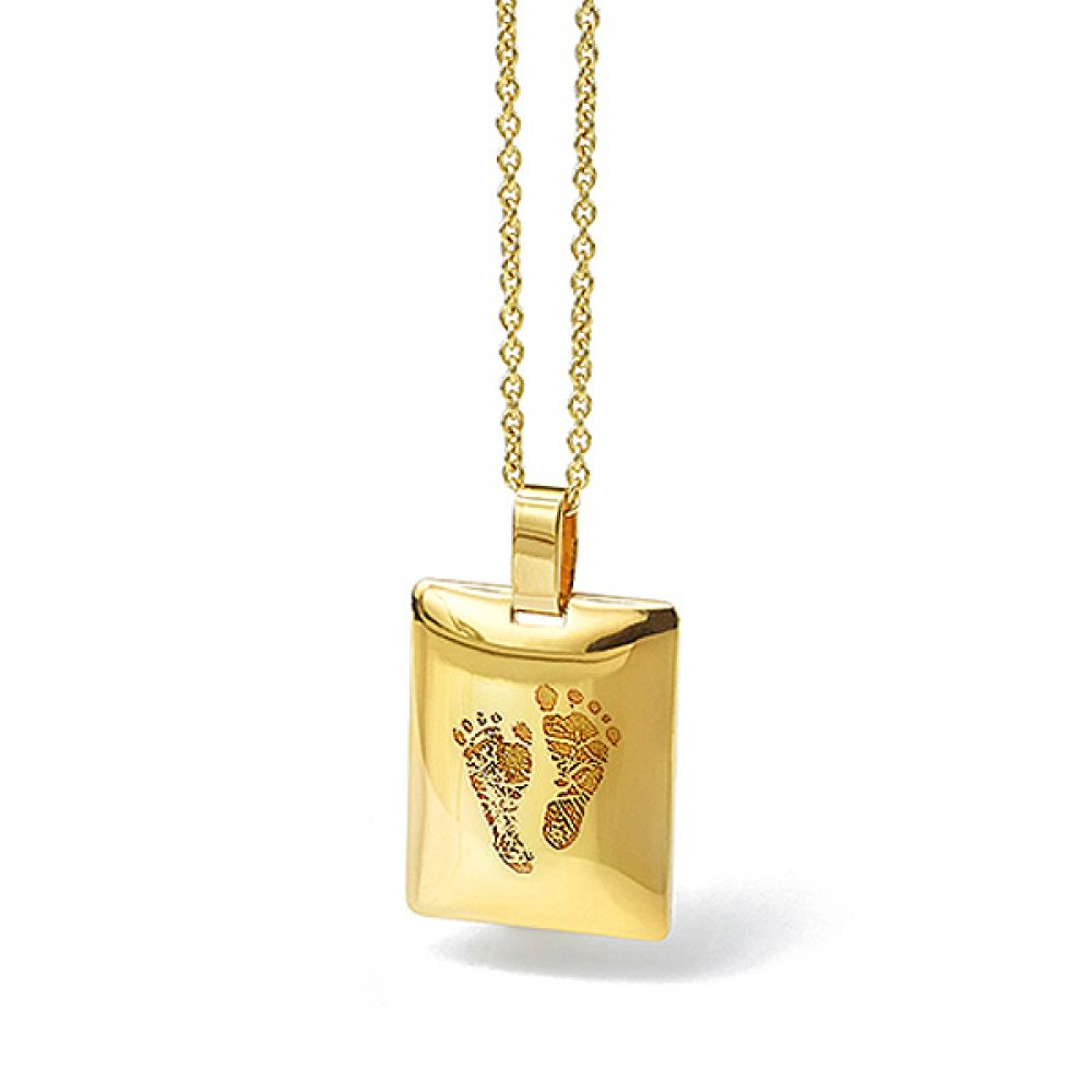 Footprint engraved pendant