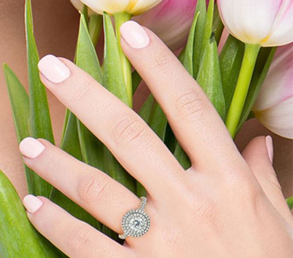 Double halo engagement ring shown on the finger