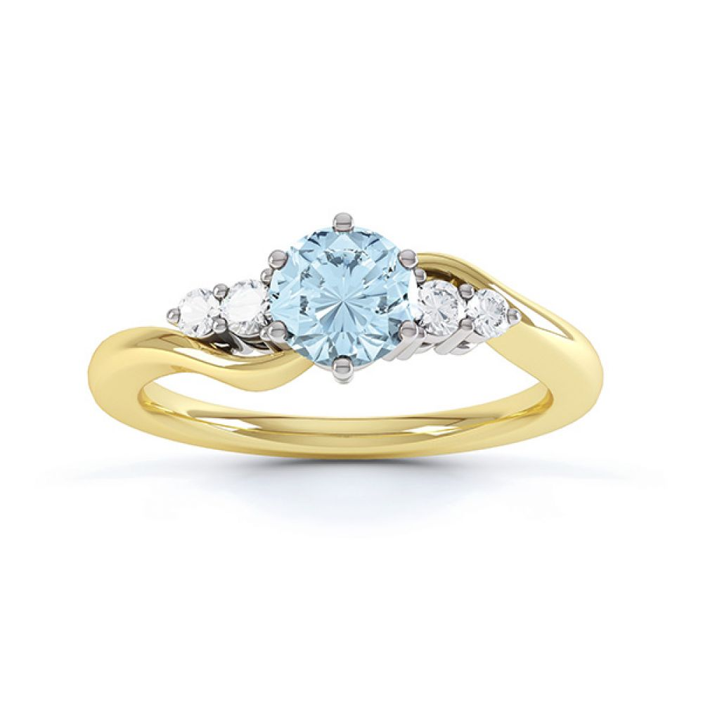 Tickled blue engagement ring top view in yellow gold