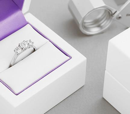 Three stone round diamond engagement rings