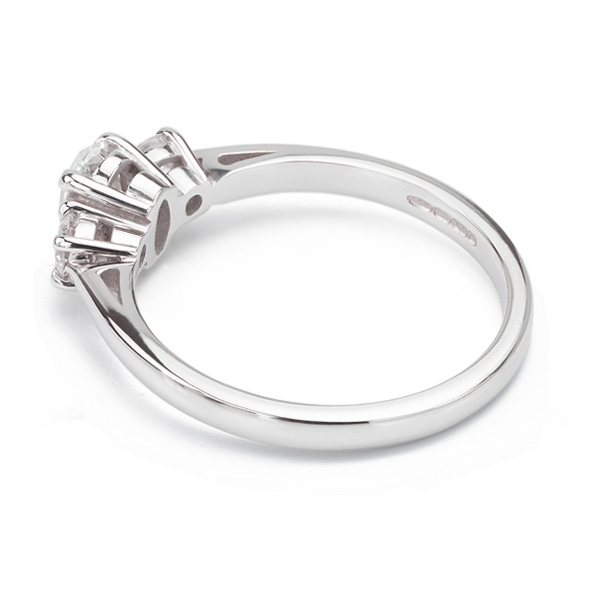 Oval and round diamond three stone ring side view white gold