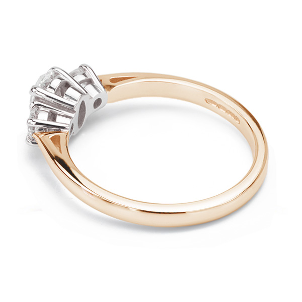 Oval and round diamond three stone ring side view rose gold