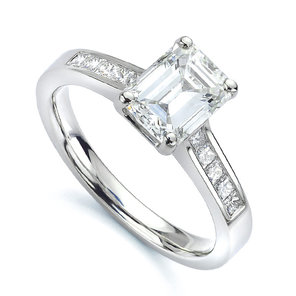 Emerald cut diamond engagement ring with Princess cut diamond shoulders white gold