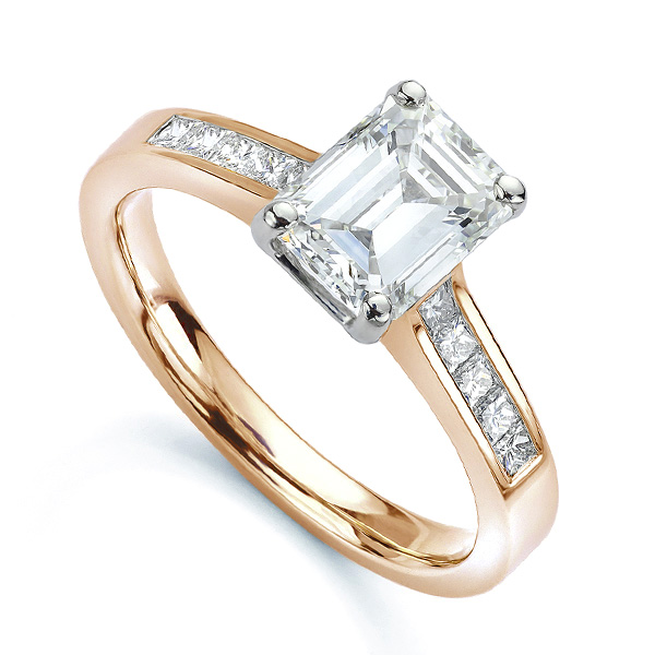 Emerald cut diamond engagement ring with Princess cut diamond shoulders rose gold