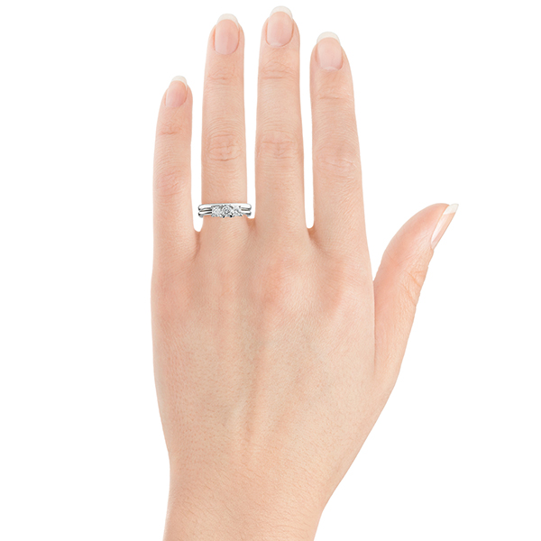 Ciel three stone engagement ring on hand