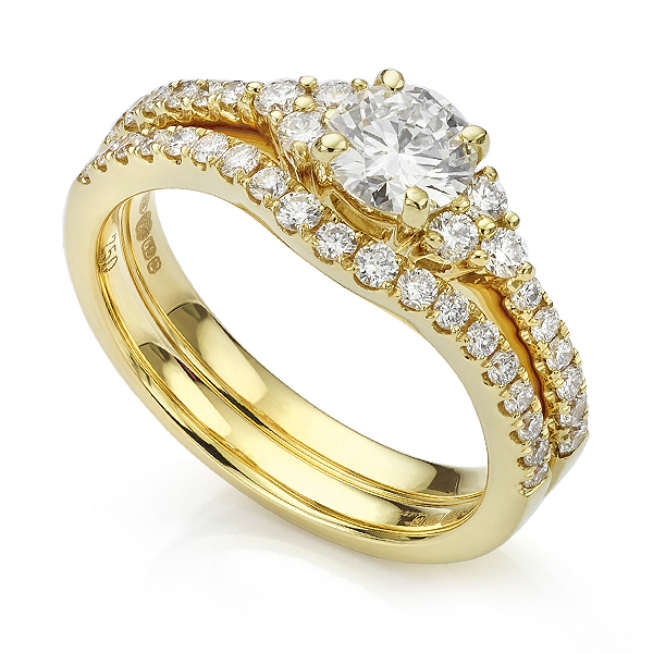 Christie diamond engagement ring shown with diamond set shaped wedding ring
