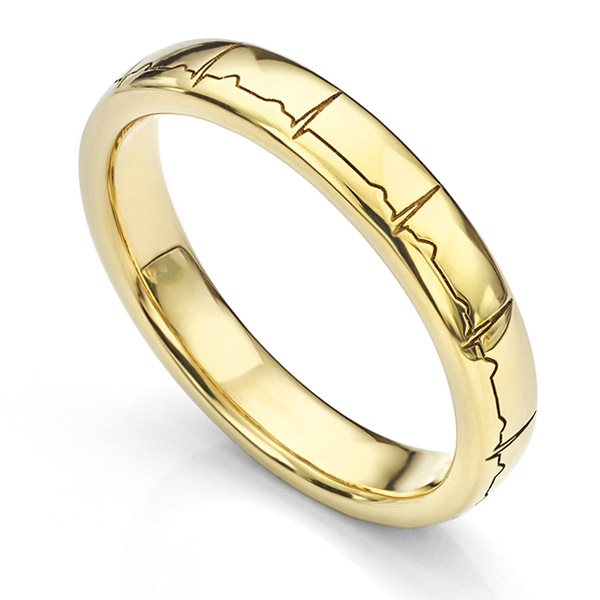 Yellow gold wedding ring engraved with a heartbeat around the outside of the ring
